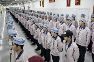 Employees being hired in a manufacturing facility